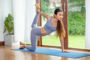 Woman in garden room doing yoga