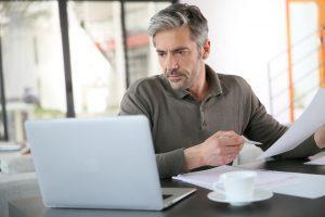 Man at laptop working